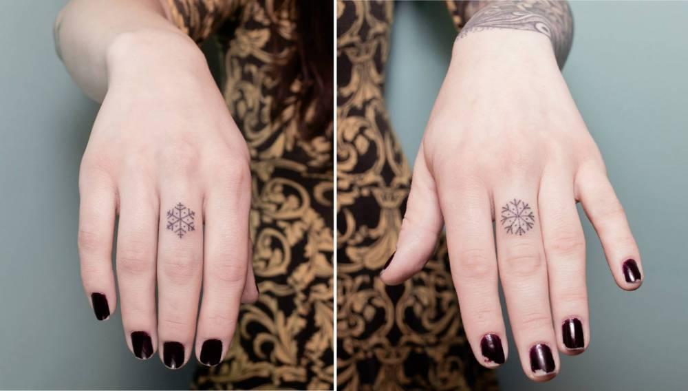 Tiny matching snowflake tattoos