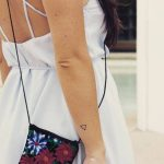 Tiny triangle tattoo on the wrist