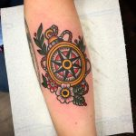 Traditional compass tattoo on the forearm