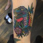 Traditional dinosaur tattoo