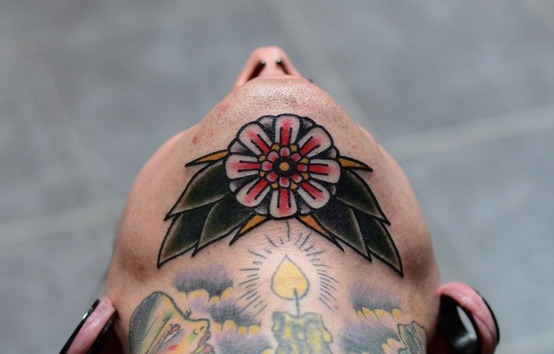 Traditional flower tattoo on the chin