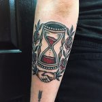Traditional hourglass tattoo on the forearm