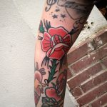 Traditional rose on the arm