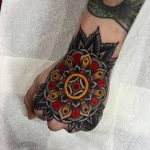 Traditional style mandala on the hand