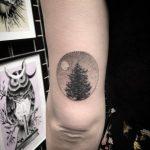 Tree in a circle tattoo