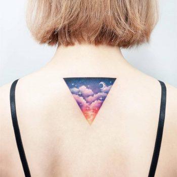 Triangular landscape tattoo on the back