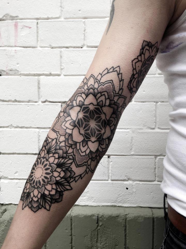 Triple black mandala tattoo