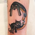 Two cats and moon tattoo