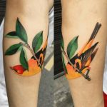 Watercolor bird tattoo on the forearm