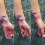 Watercolor wave tattoo on the wrist