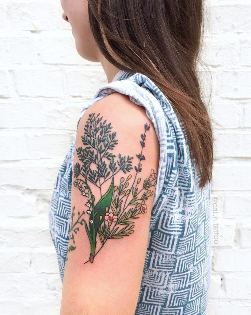 Wildflowers tattoo on the left upper arm