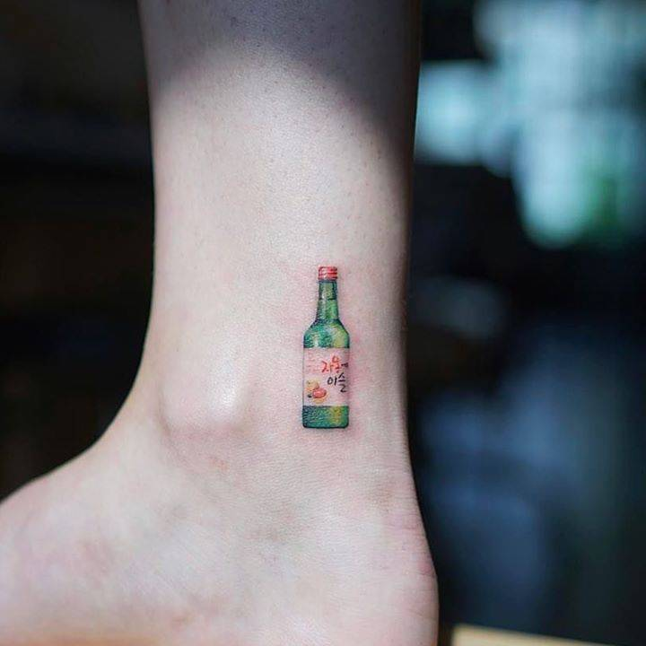 Wine bottle tattoo on the ankle