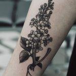 Wishbone and wildflower tattoo