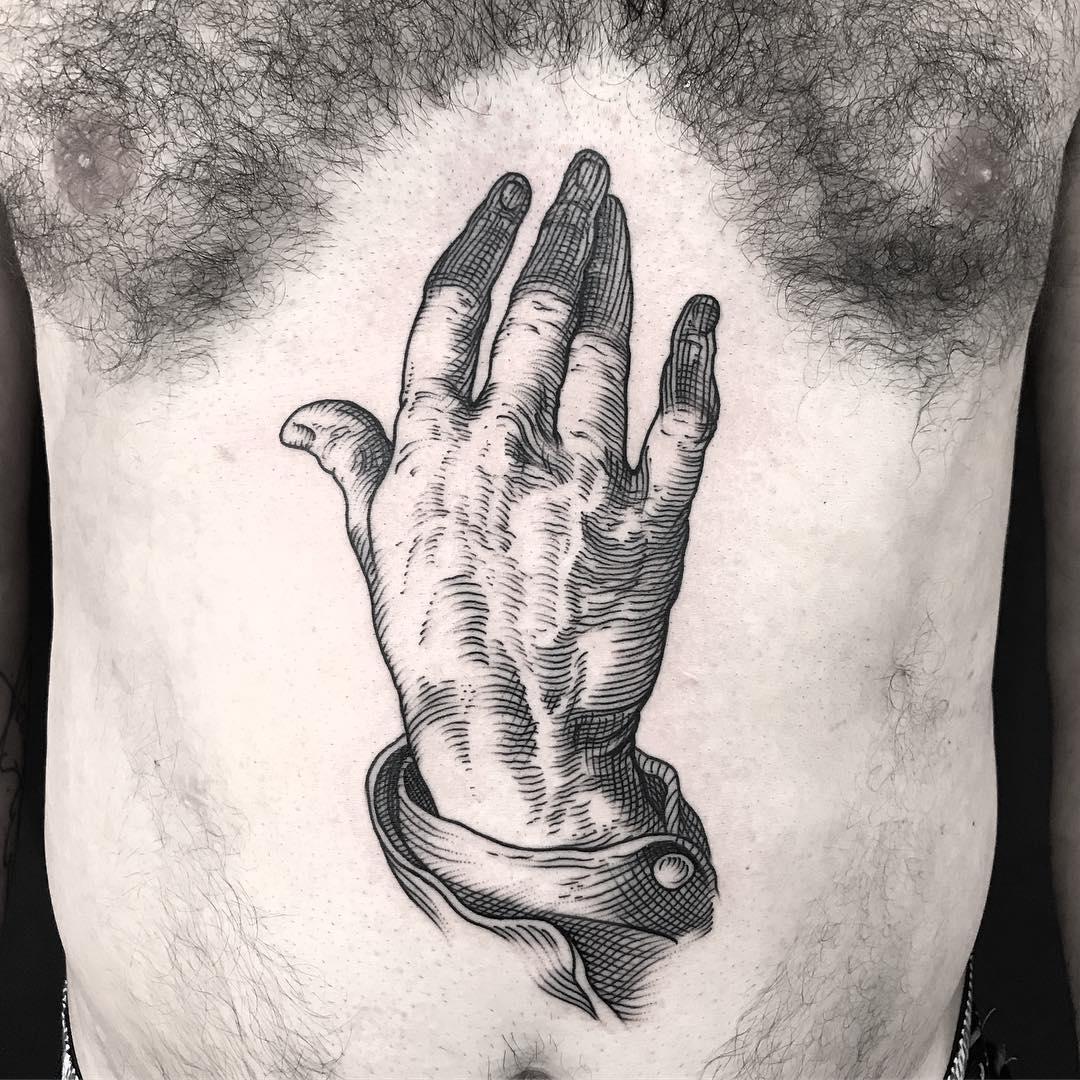 Woodcut style hand tattoo