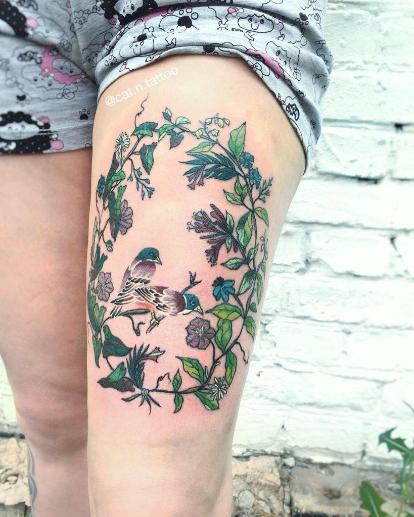 Wreath and birds tattoo