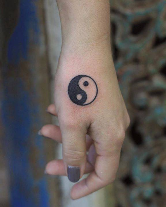 Yin and yang tattoo on the hand
