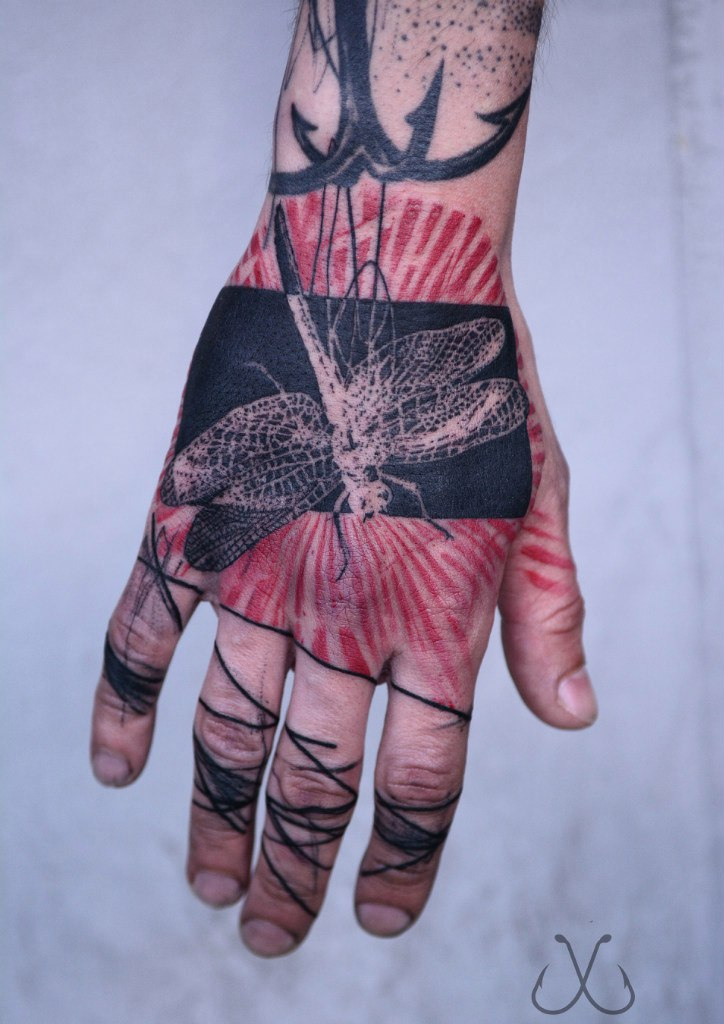 Abstract bug tattoo on the hand