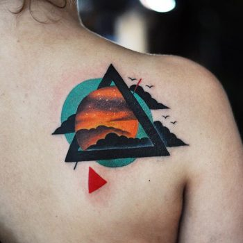 Abstract clouds and triangle tattoo