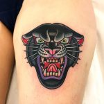 Angry panther tattoo on the thigh