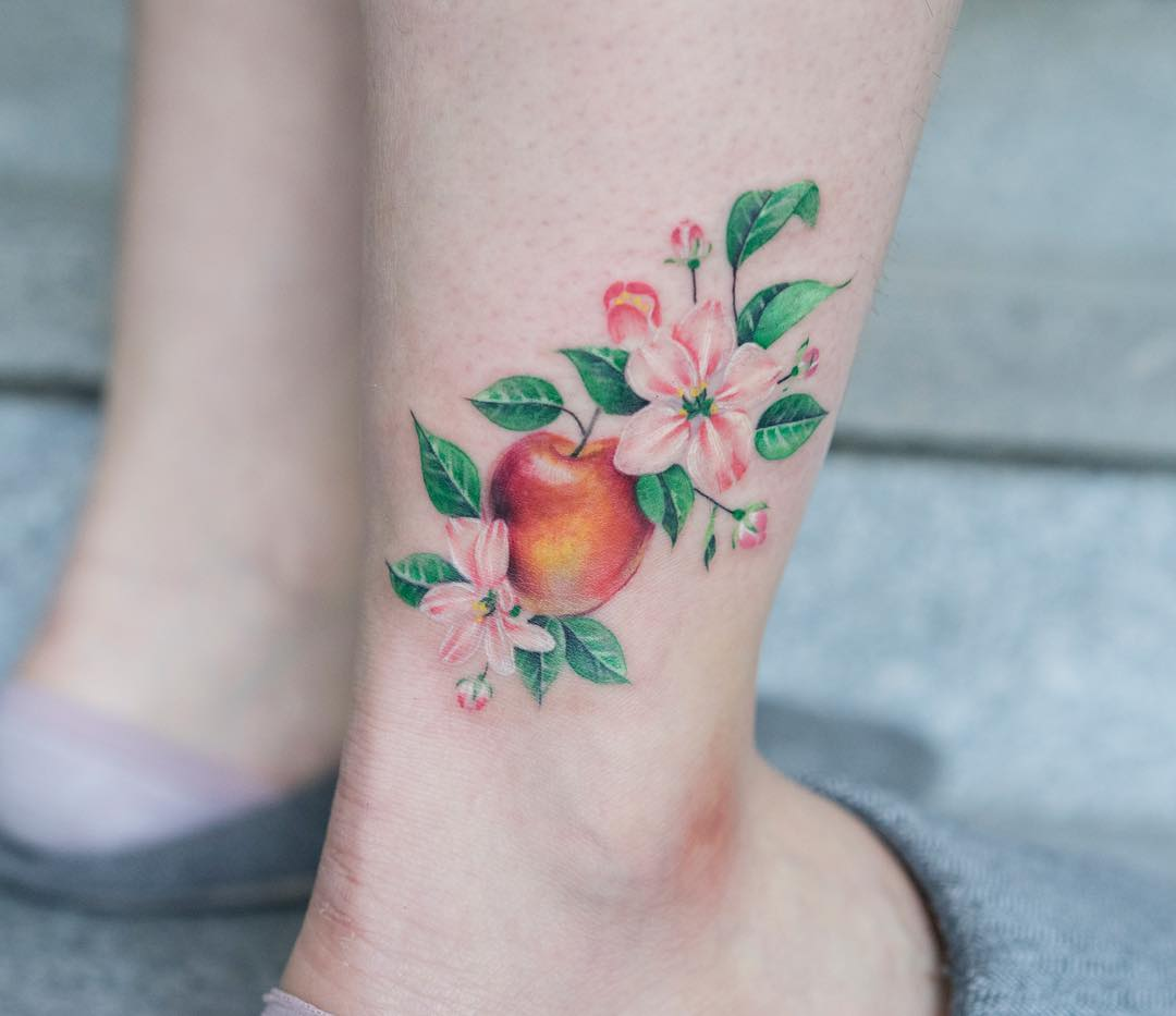 Apple tattoo on the ankle