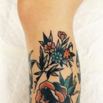 Beautiful flower tattoo on the calf