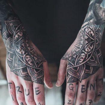 Beautiful matching stylized flower tattoos