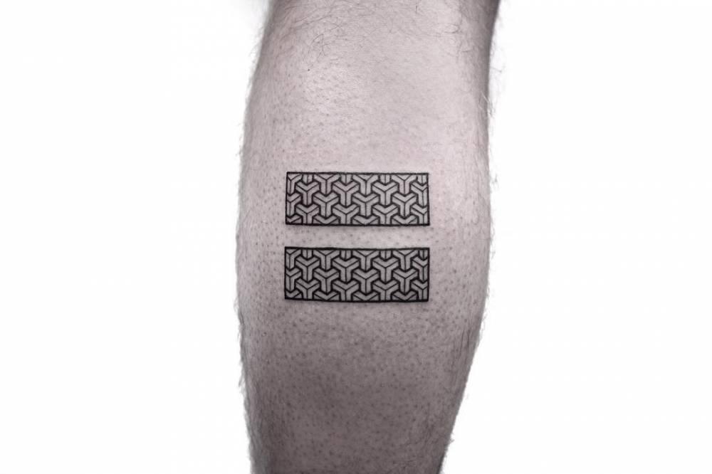 Black seamless cube pattern tattoo