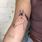 Black and grey horse tattoo