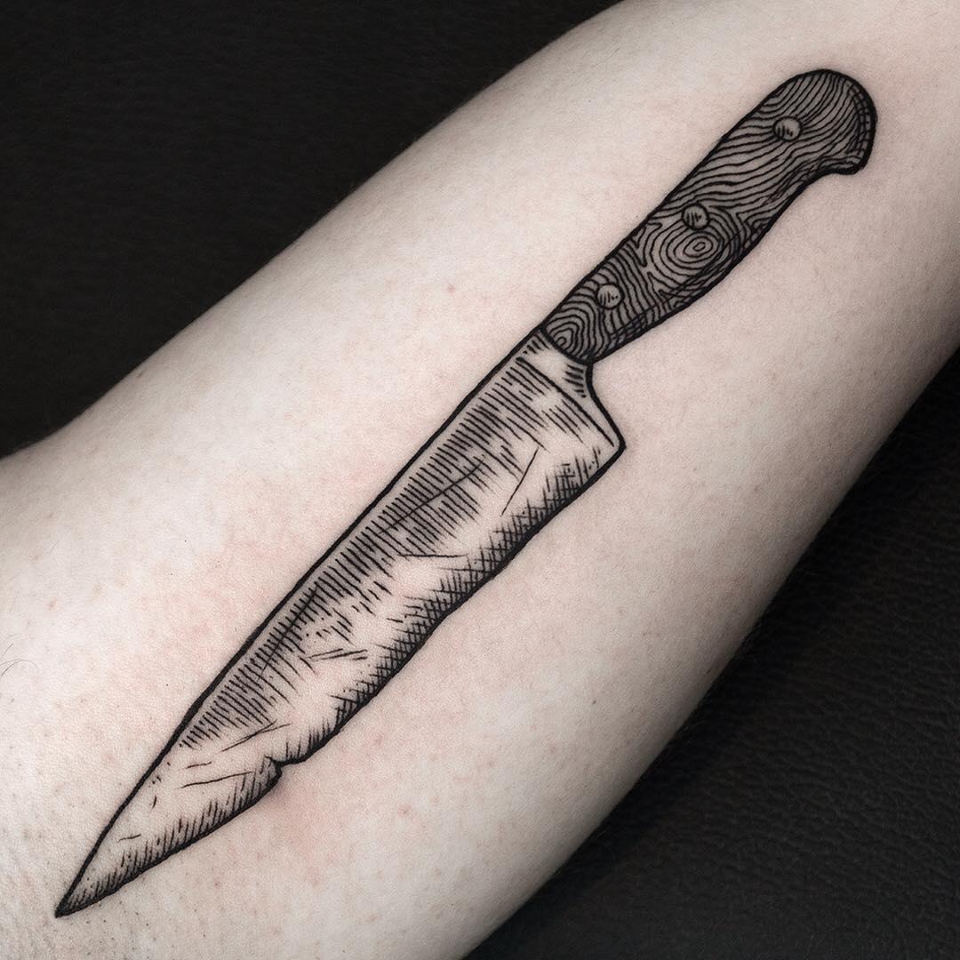 Black and grey knife tattoo