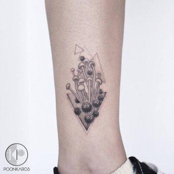 Black and grey mushrooms tattoo