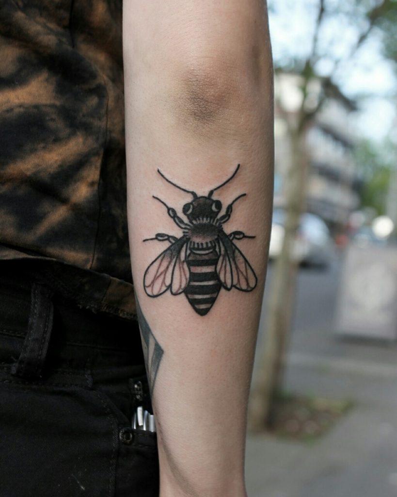Black bee tattoo