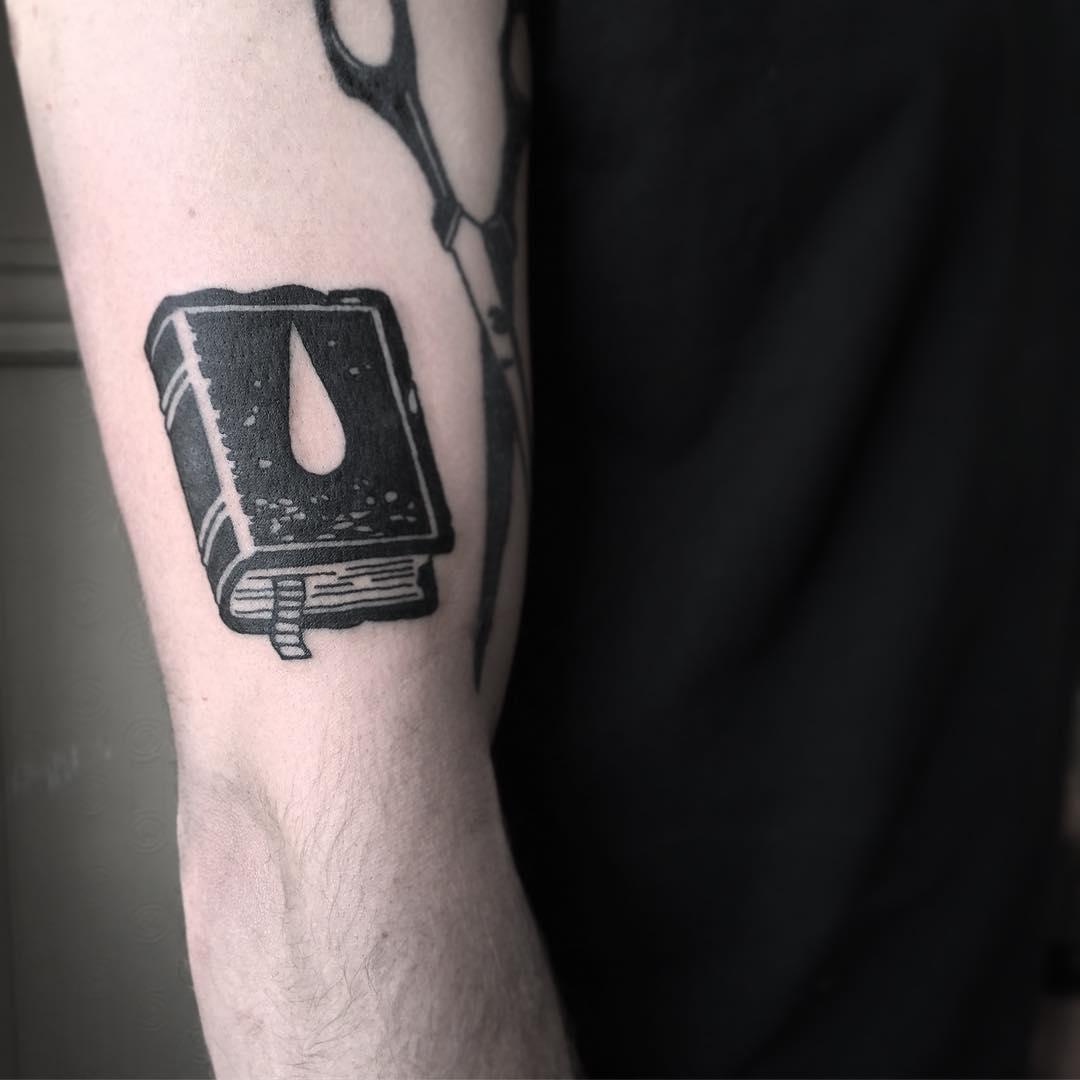 Black book tattoo