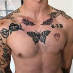 Black butterfly and other tattoos
