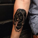 Black devil woman tattoo