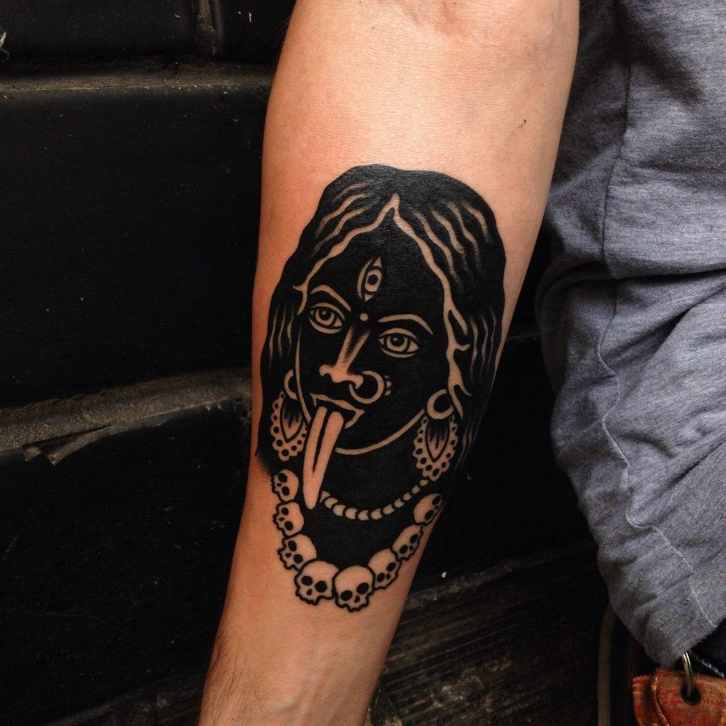 Black devil woman tattoo