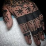Black finger tattoos
