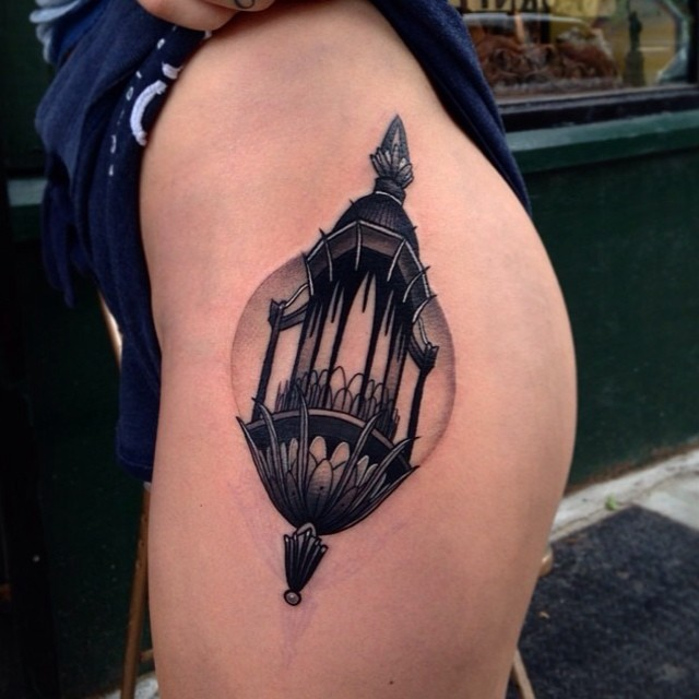 Black lantern tattoo on the hip