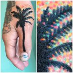 Black palm tree and sun tattoo