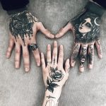 Black tattoos on hands for a couple
