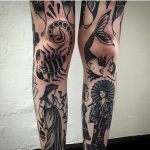 Black traditional tattoos on both legs