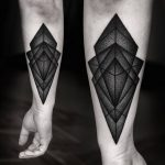 Blackwork rhombus tattoo