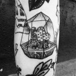 Cacti in a terrarium tattoo