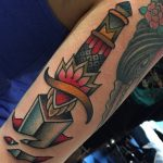 Classy dagger stabbed in skin tattoo