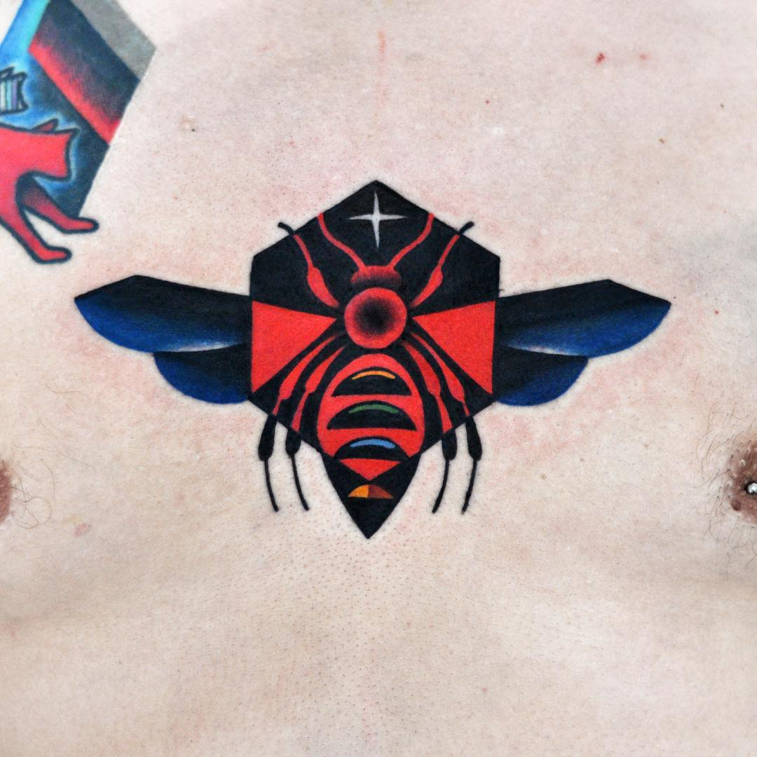 Colorful bee tattoo on the chest
