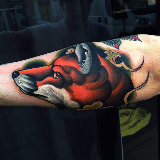 Colorful fox tattoo on the arm