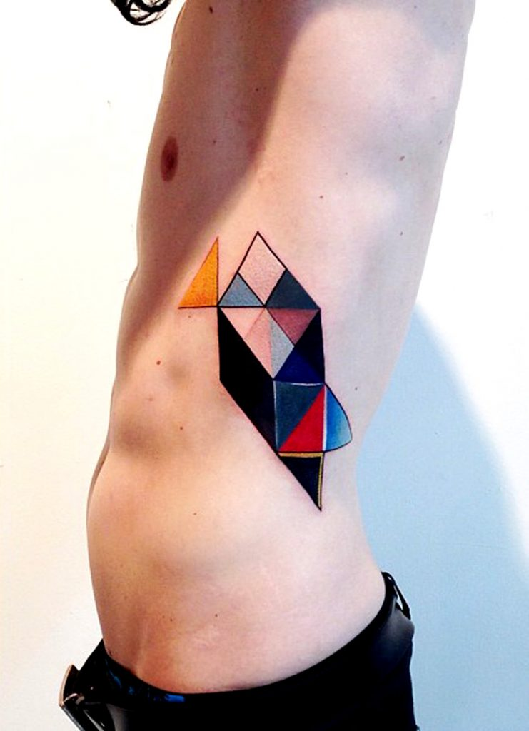Colorful geometric tattoo on the left rib cage