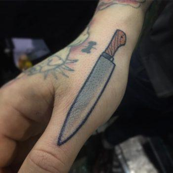 Cool knife tattoo on the thumb