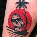 Cool skull and sunset tattoo