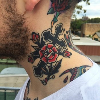 Cross and rose tattoo on the neck