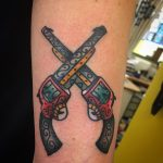Crossed revolvers tattoo